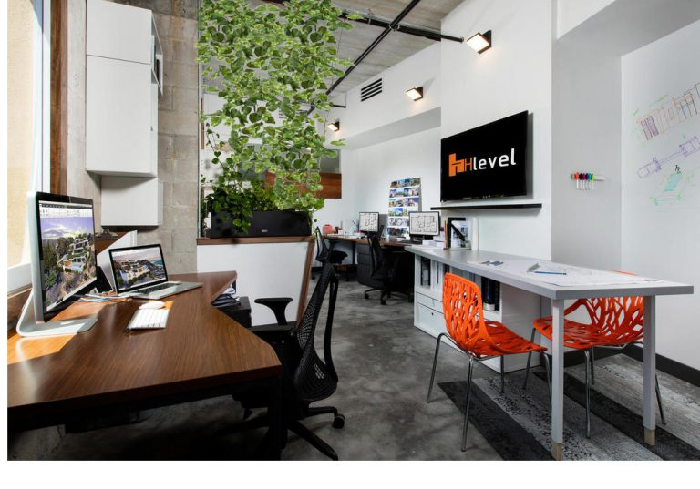 Hlevel architecture Office interior view orange chair green wall dry erase wall